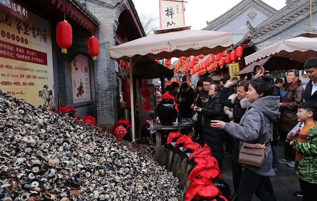 西安摔碗酒的地址在哪里,西安城墙脚下的永兴坊